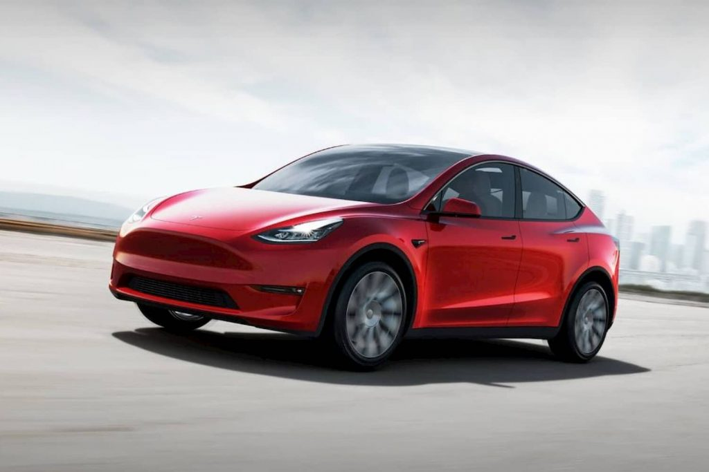 tesla model y review. Side view.