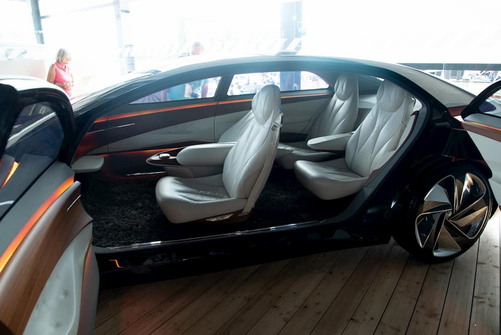 vw id vizzion electric concept car from the side view with opened doors